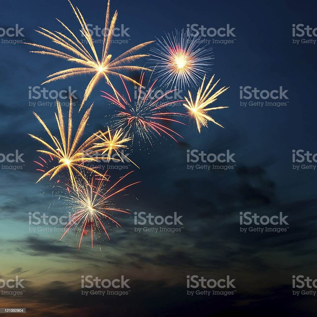 Brightly colorful fireworks  in the night sky stock photo
