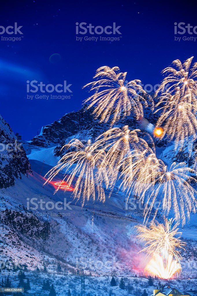 Brightly colorful fireworks   Night high mountain winter landscape stock photo