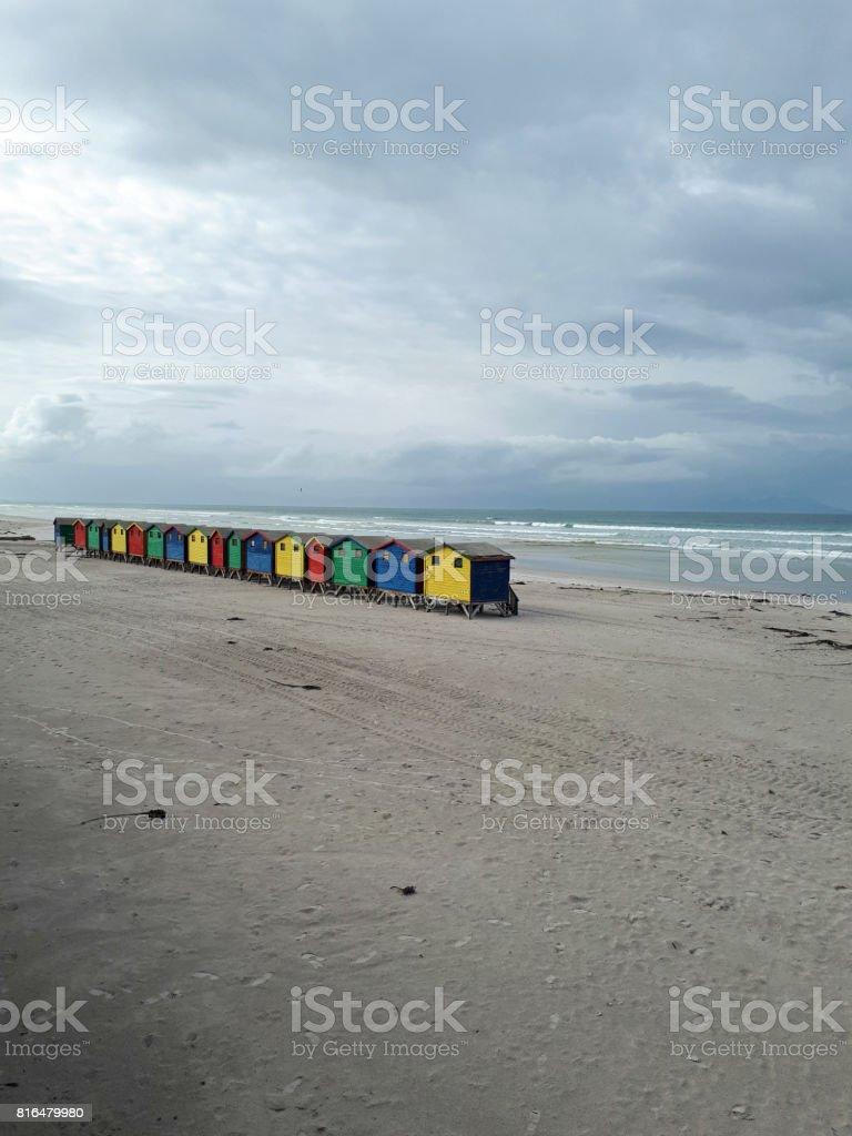 Brightly coloured beach huts stock photo