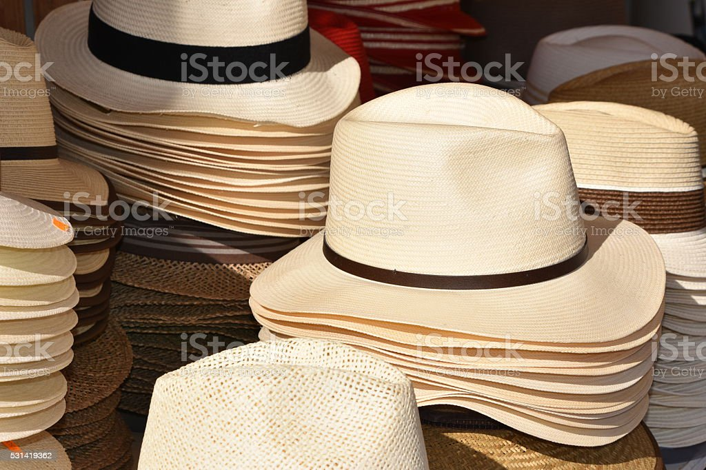 Brightly coloured hats on street market stall stock photo
