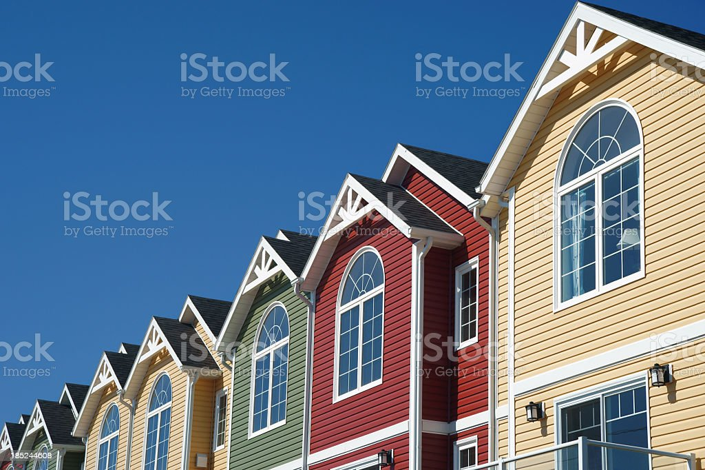 Brightly coloured town houses stock photo