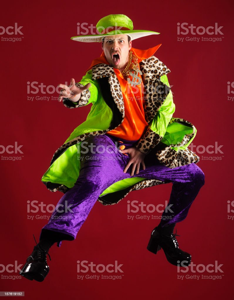 Brightly Dressed Man in Mid-Air stock photo