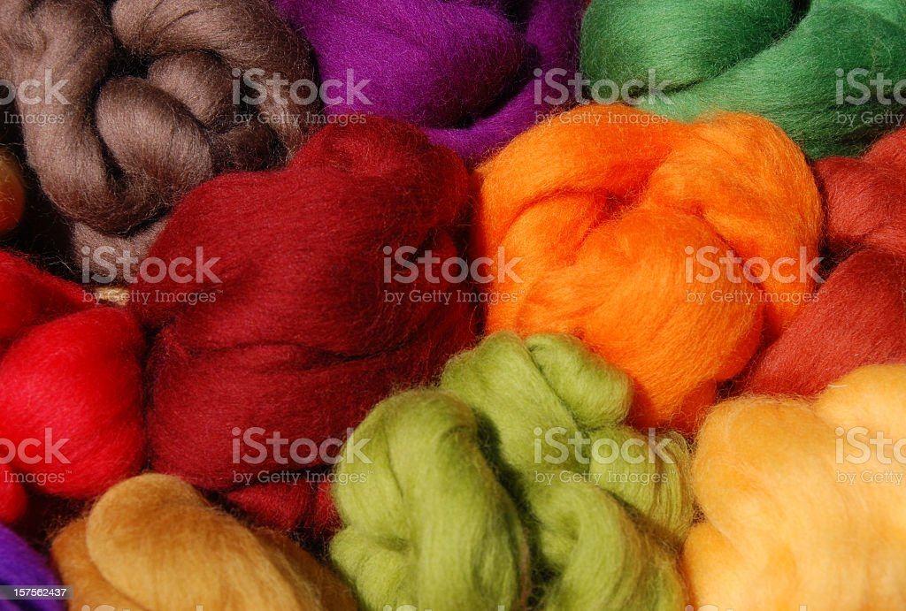 Brightly dyed new wool in a variety of colors stock photo