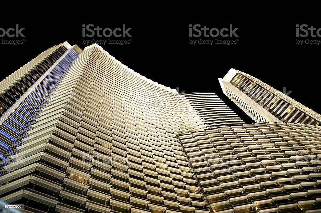 Brightly lit building at night stock photo