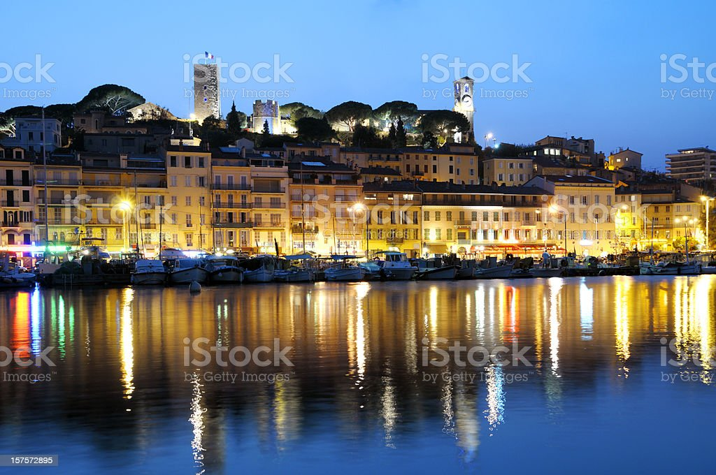 Brightly lit Cannes in the evening stock photo