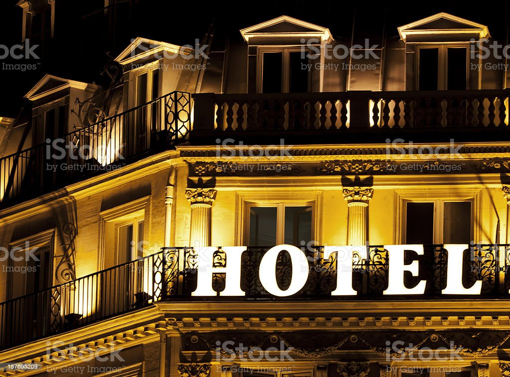 Brightly lit HOTEL sign on a hotel balcony stock photo