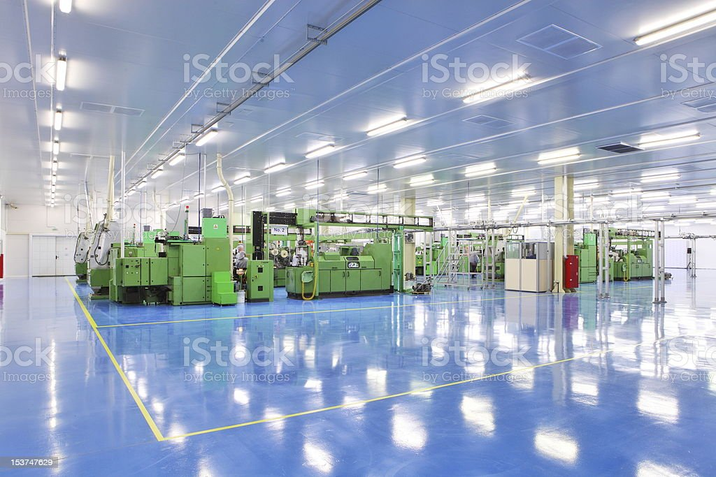 Brightly lit industrial space with equipment stock photo