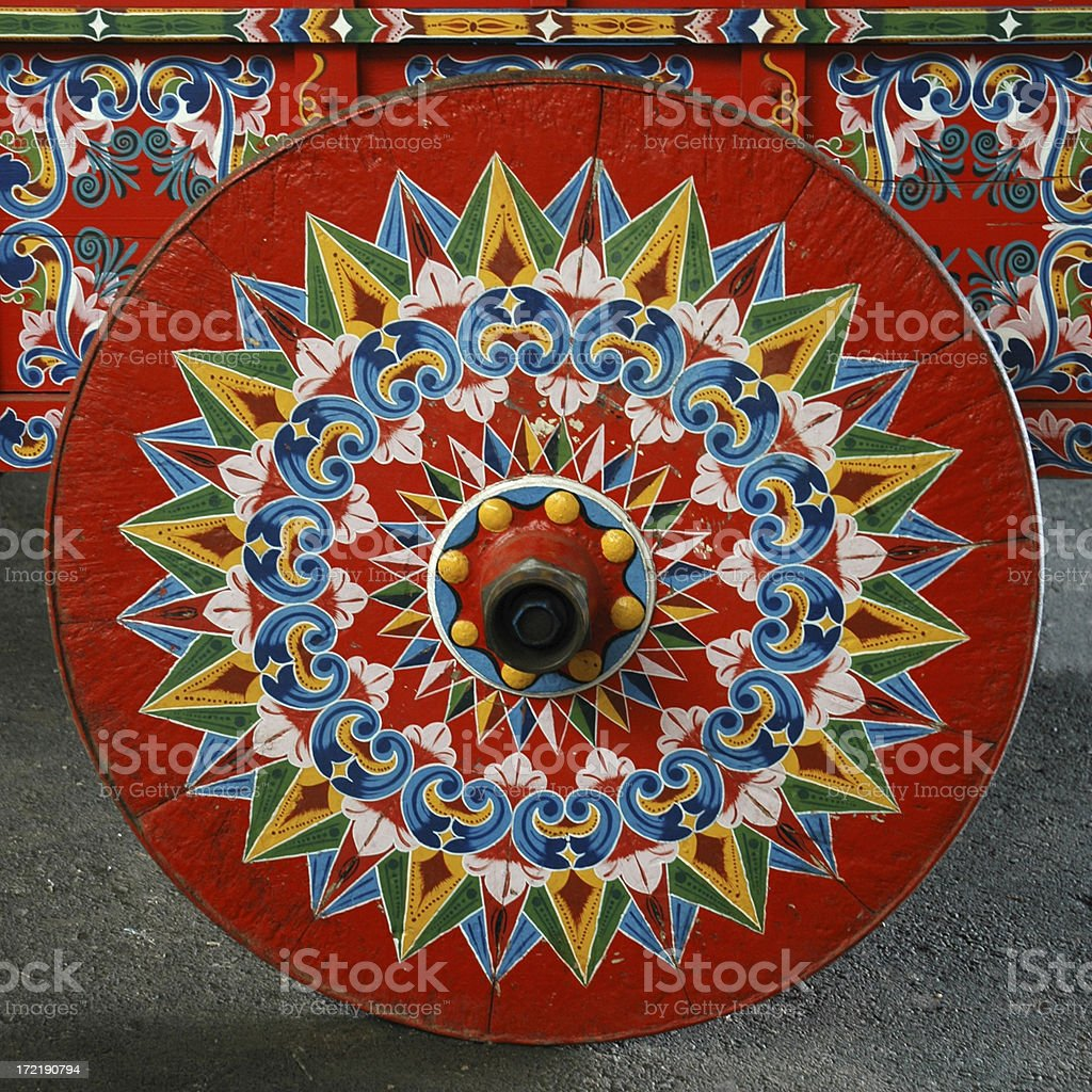 Brightly painted coffee cart wheel stock photo