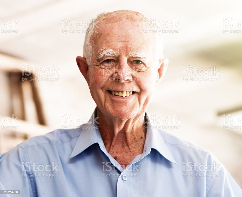 Brightly smiling 90 year old active senior man enjoying life stock photo