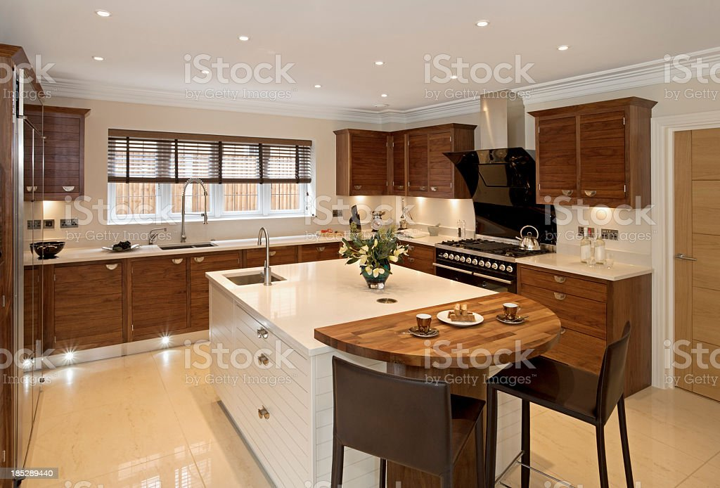 Brightly-lit large modern kitchen stock photo
