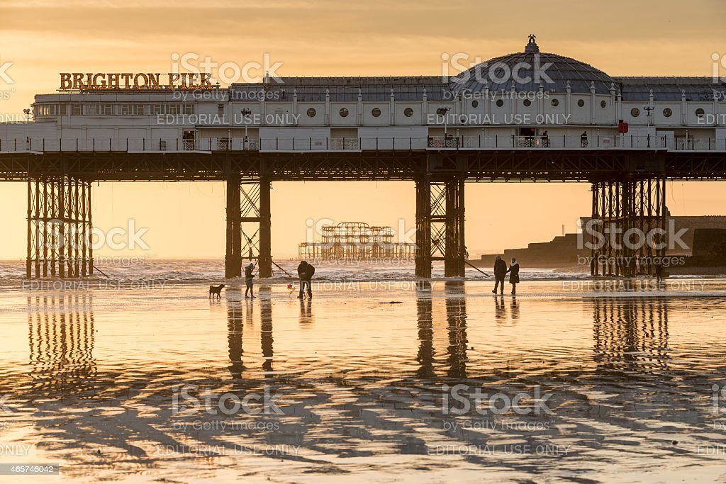 Brighton and West Piers at sunset stock photo
