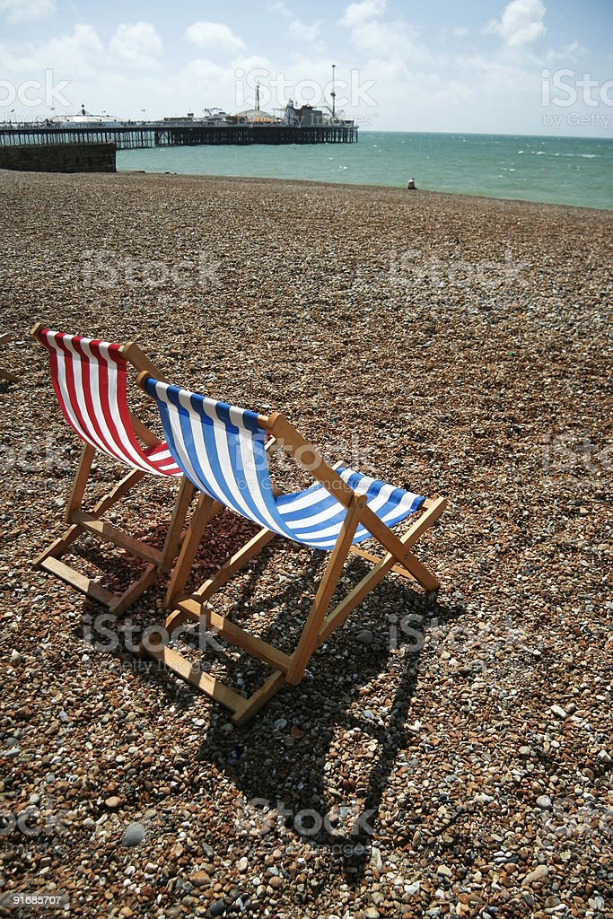 brighton beach deckchairs palace pier royalty-free stock photo