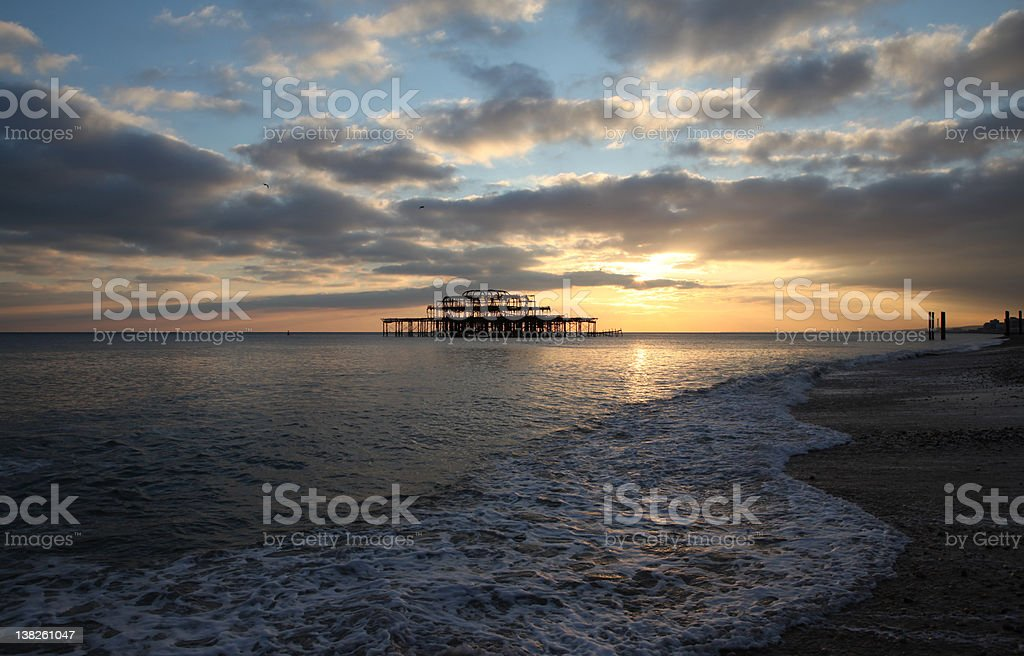 brighton pier sunset waves stock photo
