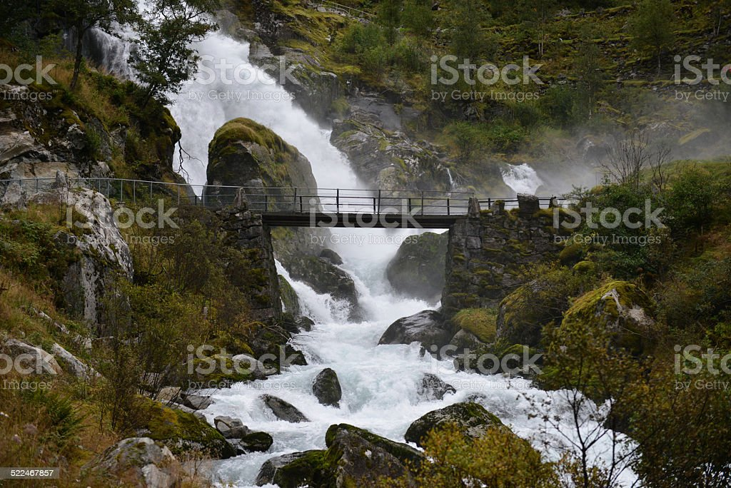 Briksdal Water Fall and Bridge stock photo