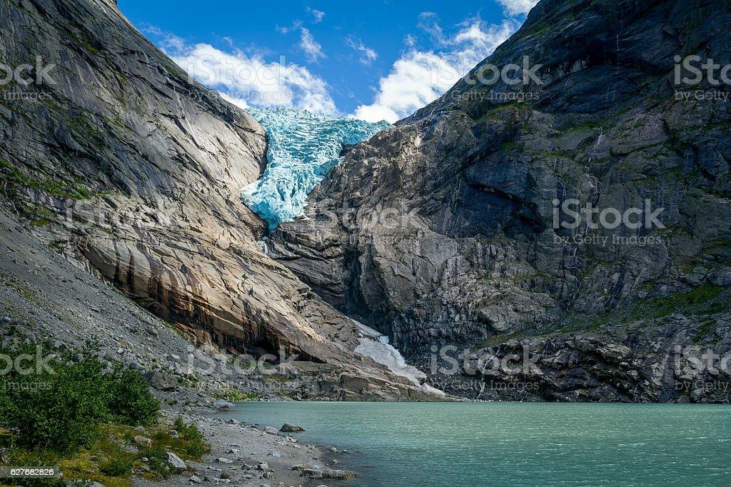 Briksdalsbreen glacier and sun beam stock photo