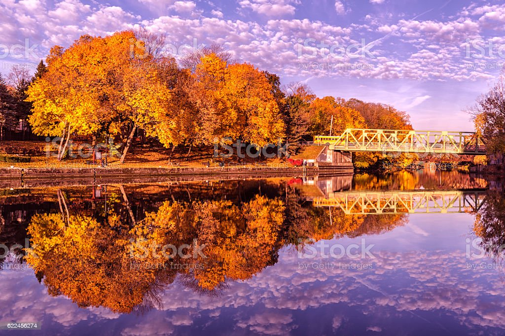 Brilliant Autumn Morning Erie Canal Foliage Colors and Reflections stock photo