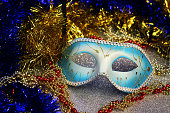 Brilliant blue carnival mask close up on shiny background with