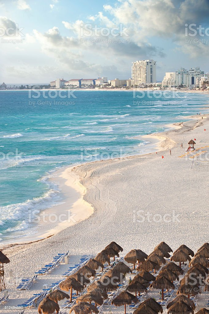 Brilliant blue sea and curving beach in Cancun, Mexico stock photo