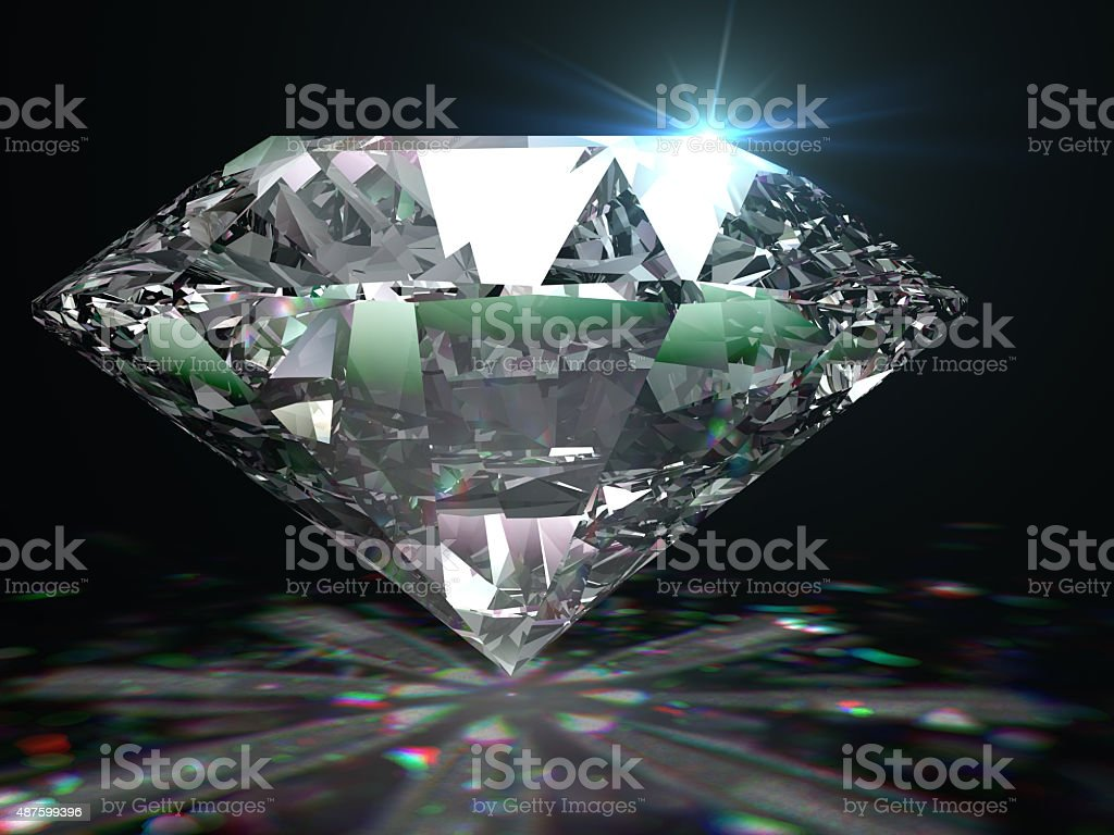 Brilliant diamond on black surface. stock photo