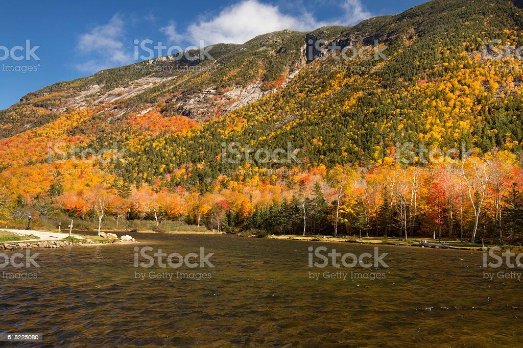 Brilliant fall foliage at Saco Lake in the White Mountains. stock photo