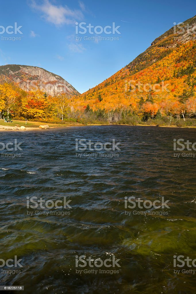 Brilliant fall foliage at Saco Lake in the White Mountains. stock photo