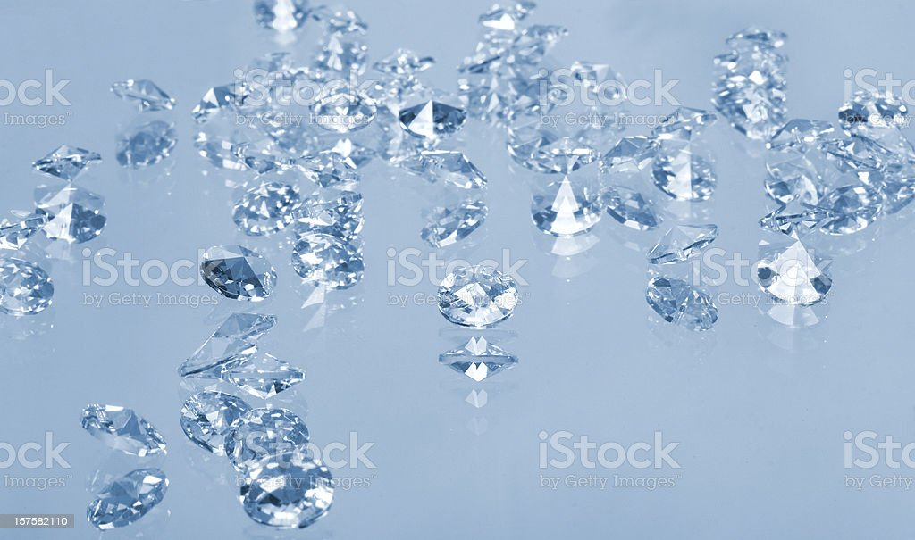 brilliant gems, isolated on blue stock photo