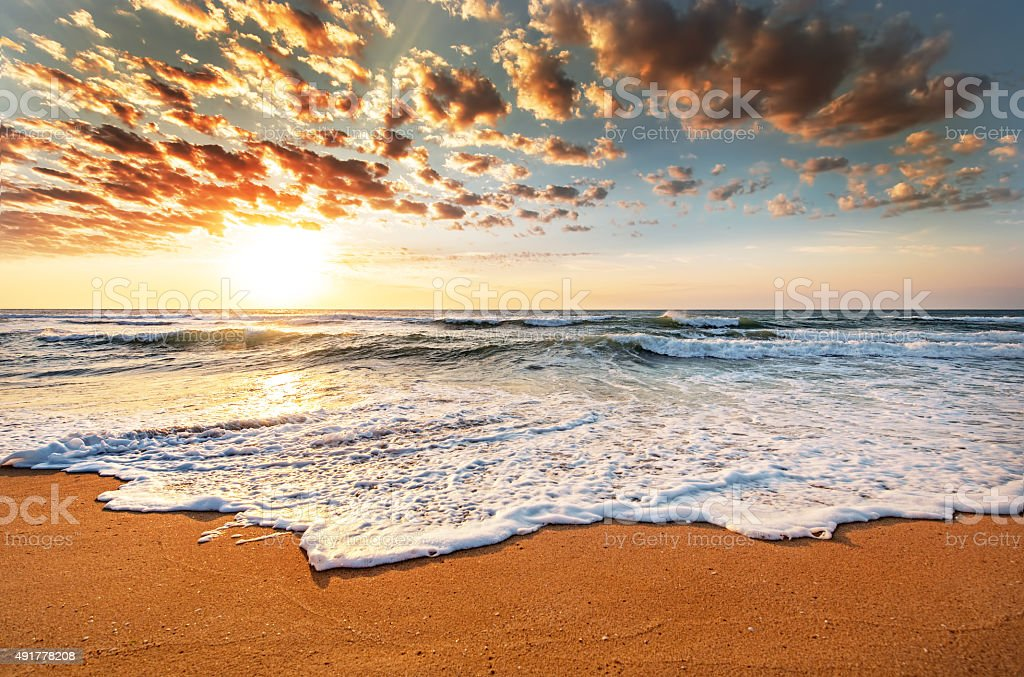 Brilliant ocean beach sunrise. stock photo