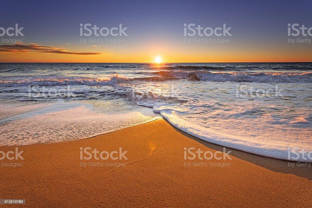 Brilliant ocean beach sunrise. stock photo