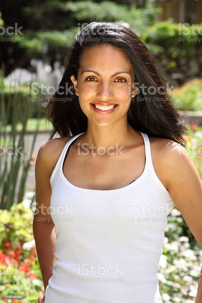 Brilliant smile from stunning young beauty in garden sunshine royalty-free stock photo