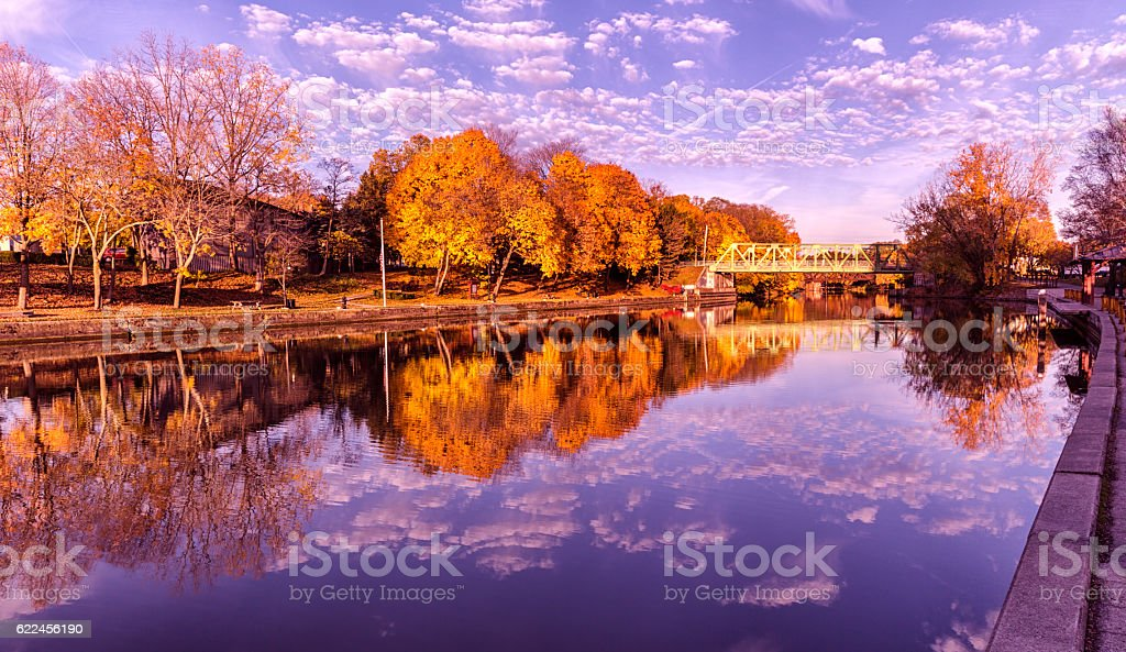 Brilliant Vibrant Late Autumn Erie Canal Foliage Colors and Reflections stock photo