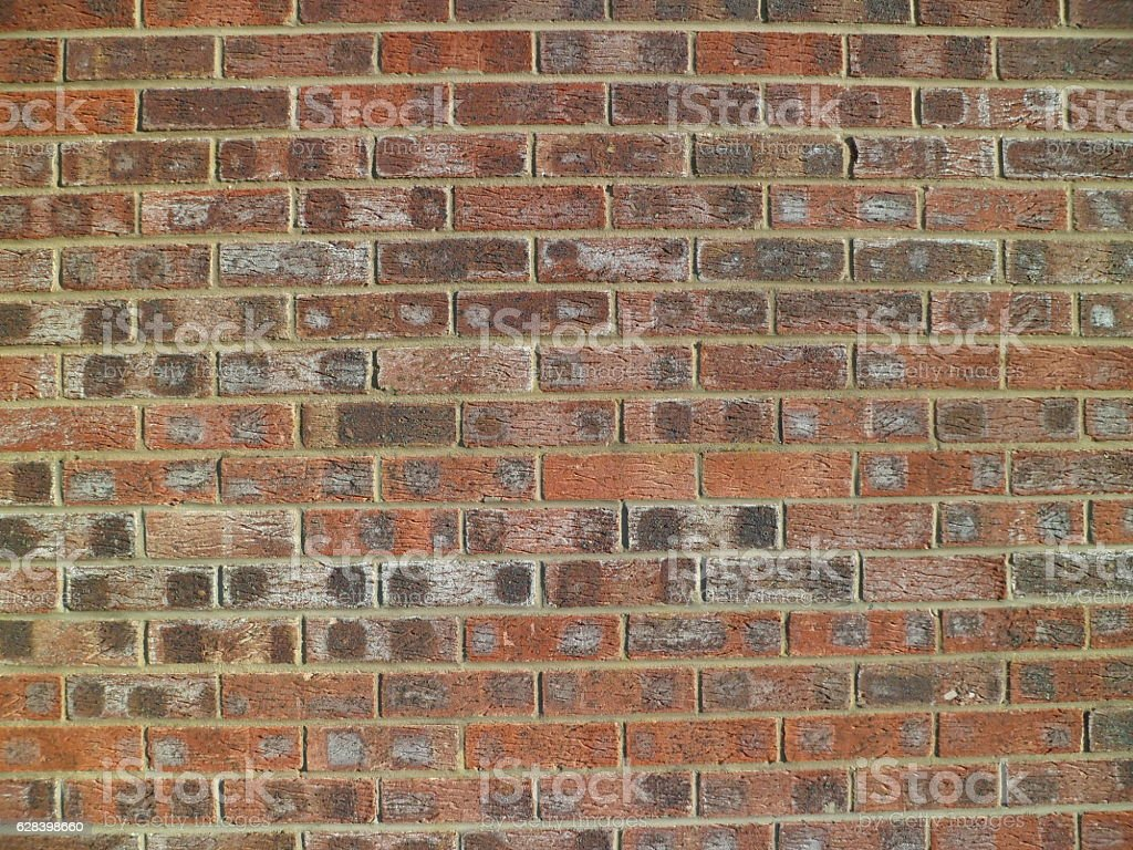 Brindled, spotted brick wall (fifteen courses) stock photo