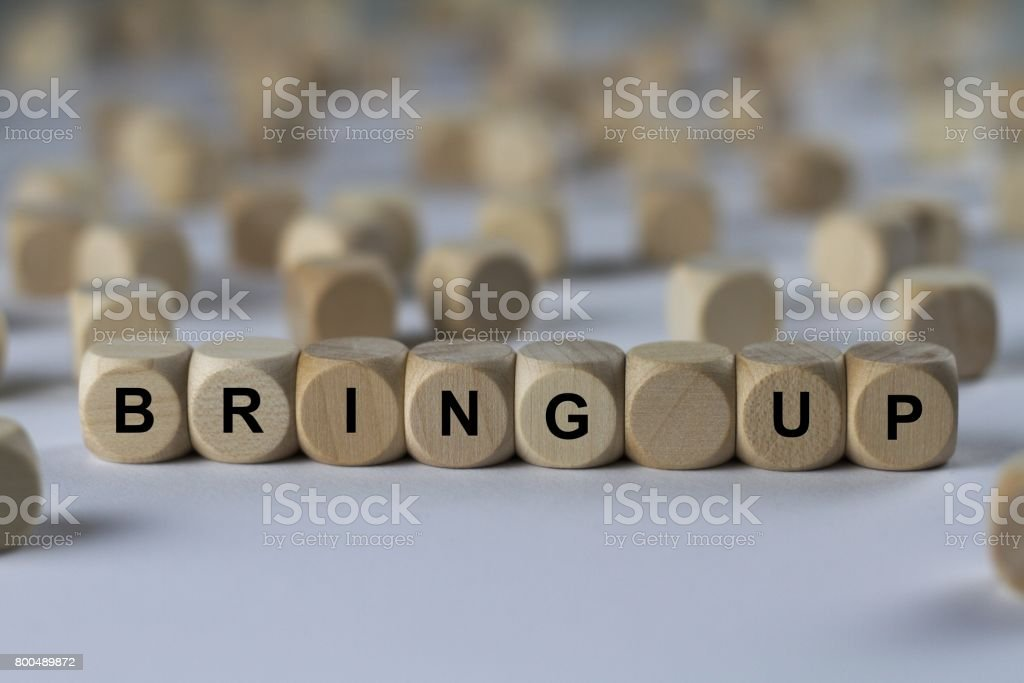 bring up - cube with letters, sign with wooden cubes stock photo