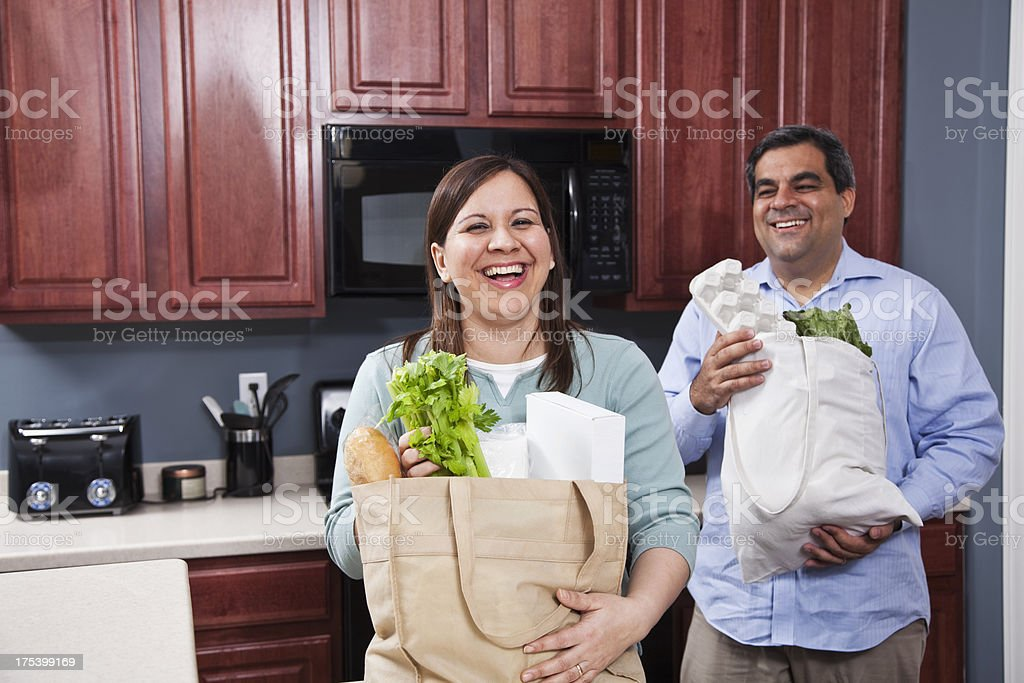Bringing groceries home stock photo