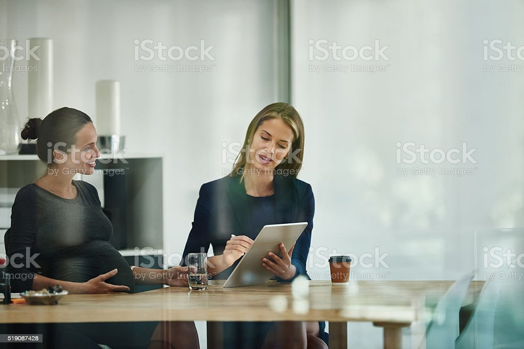 Bringing her colleague up to speed stock photo