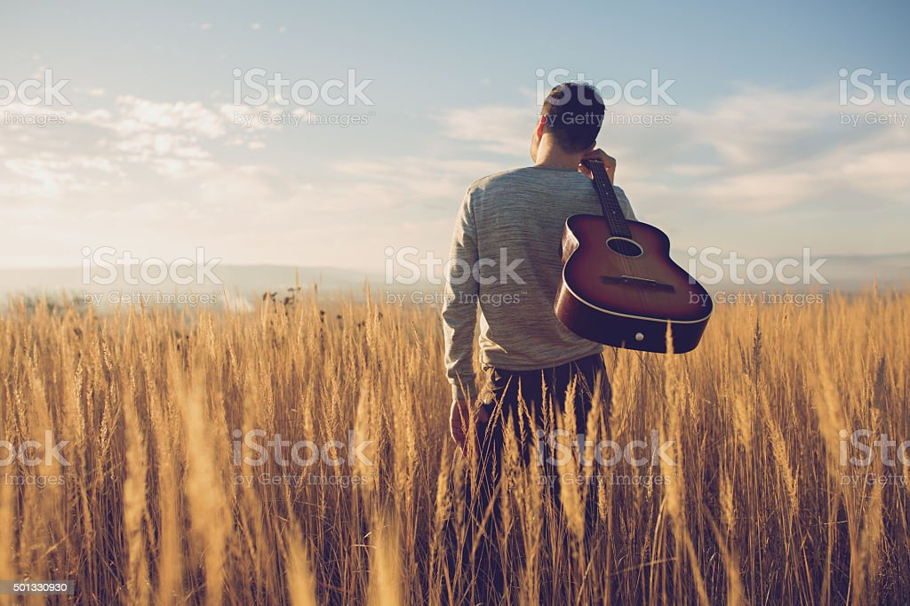 Bringing My Guitar Wherever I Go stock photo
