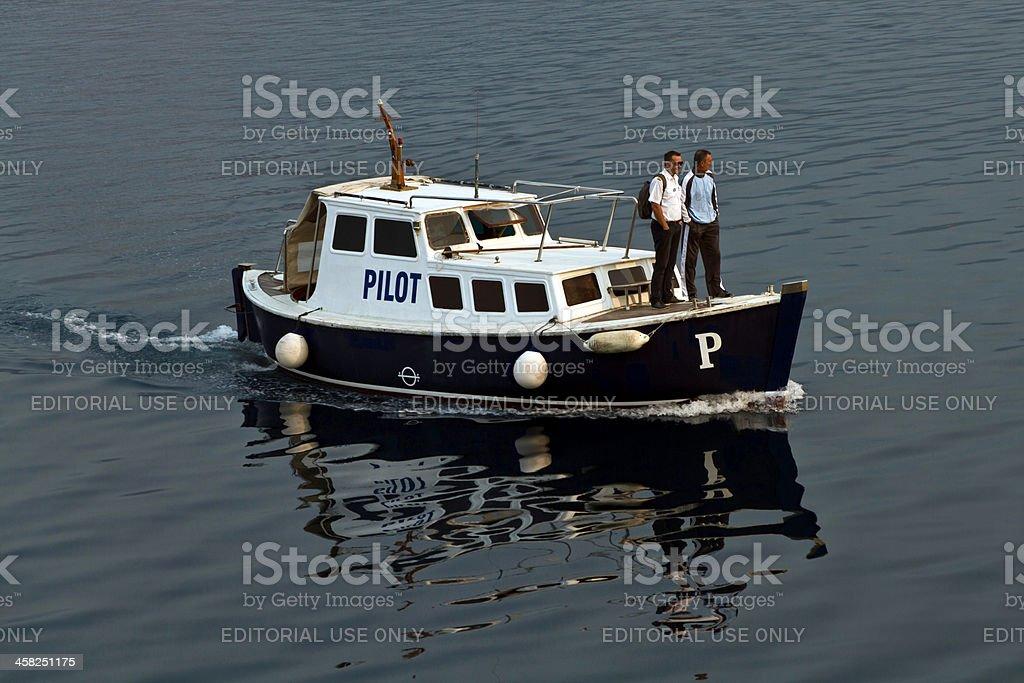 Bringing pilot aboard at entrance to Bay of Kotor, Montenegra royalty-free stock photo
