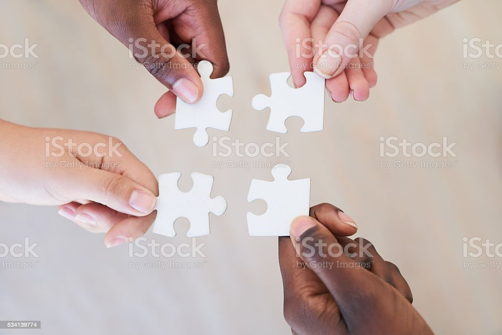 Bringing the pieces together stock photo