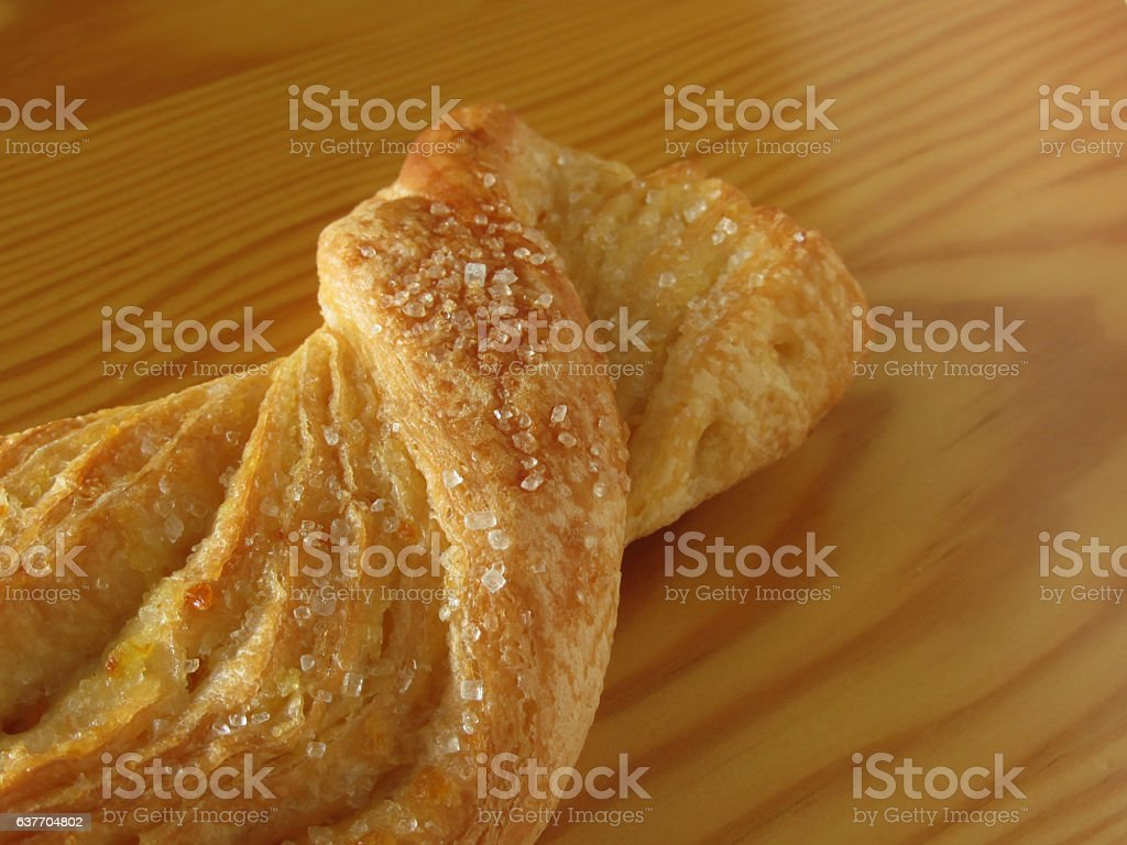 Brioche on a wooden table with granulated sugar garnish stock photo