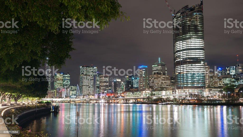 Brisbane city skyline lights across river at night stock photo