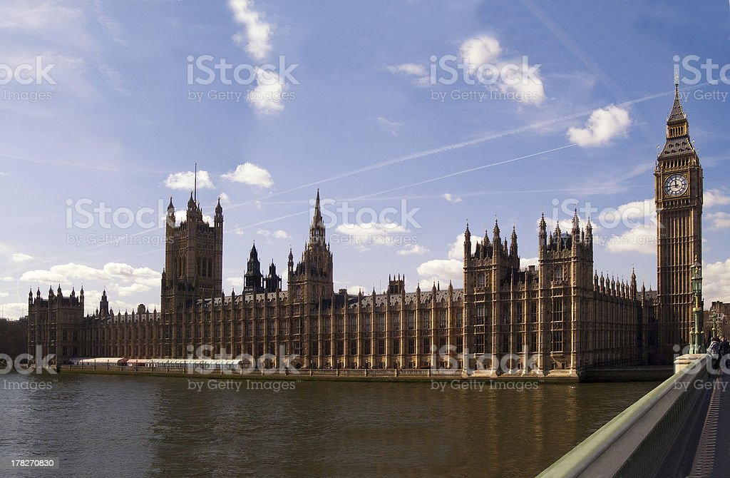 Britains Parliament and 'Big Ben' with clouds and contrails royalty-free stock photo