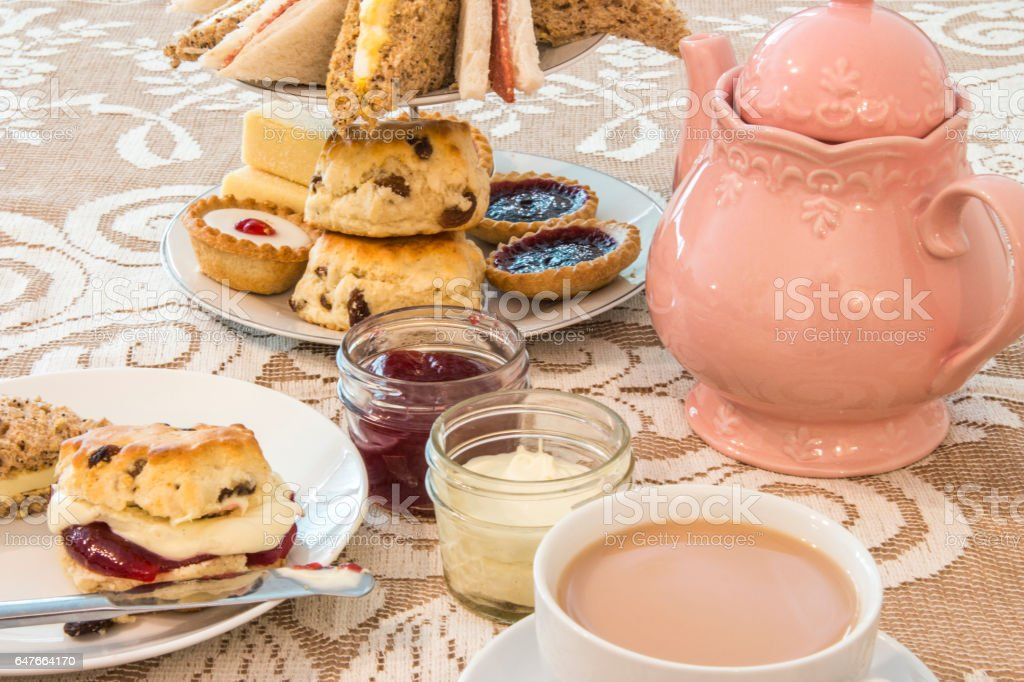 Vintage Afternoon Tea the traditional way, with sandwiches, cakes and...