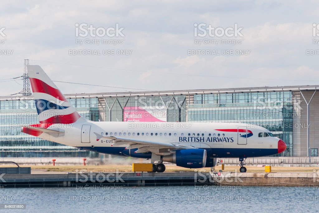 A British Airways Airbus A-318 (G-EUNB) rolls on the runway of the London City Airport in the borough of Newham before take off stock photo