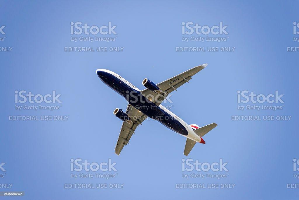 British Airways Airplane in blue sky stock photo