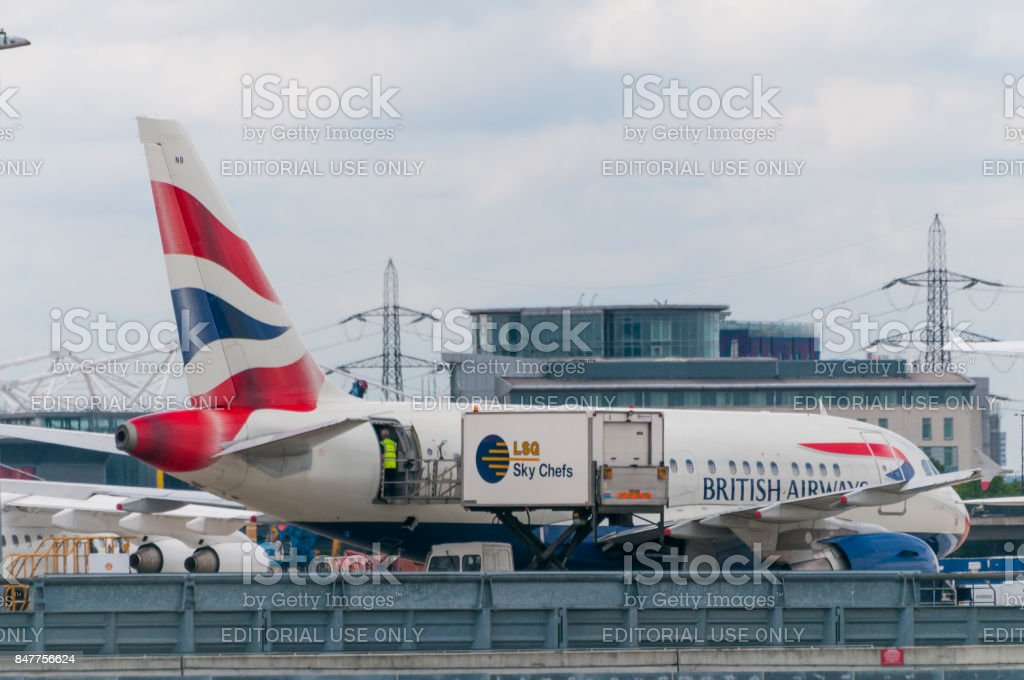 A British Airways airplane loading catering before take off in London City Airport stock photo