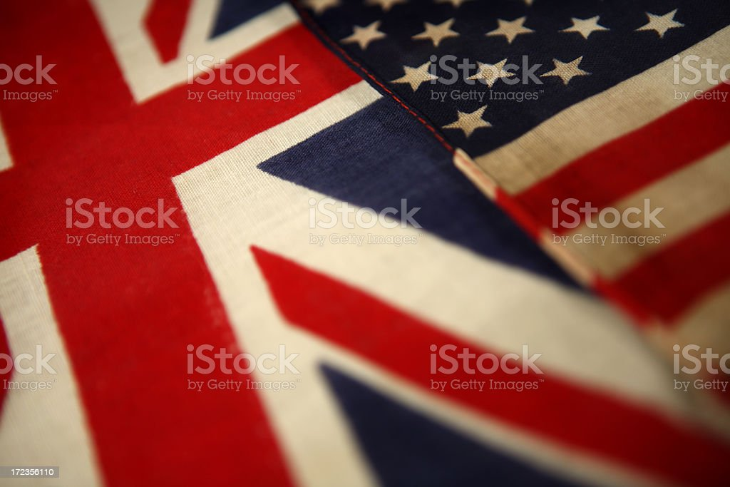 British and American flags laying next to each other royalty-free stock photo