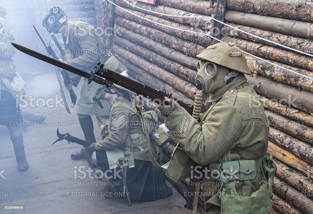 WWI British Army soldiers stand ready under poison gas attack stock photo
