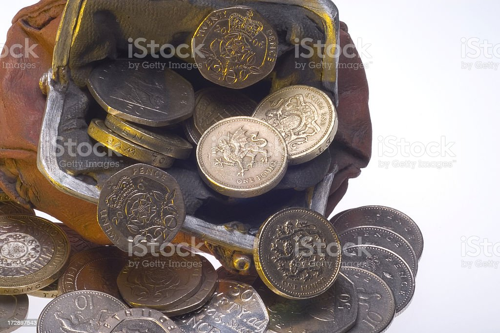 British Coins Falling From Purse stock photo