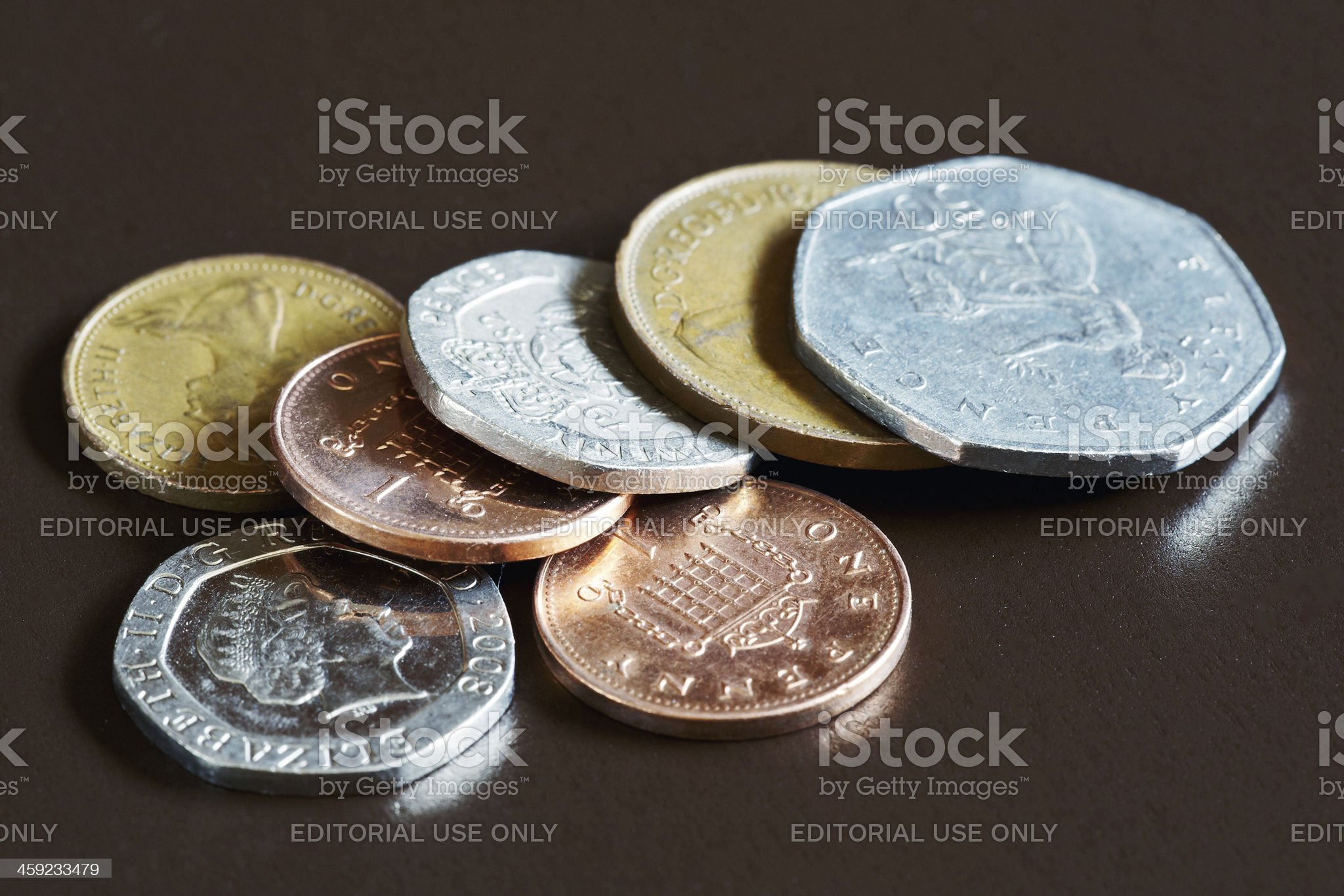 British coins on dark brown background royalty-free stock photo