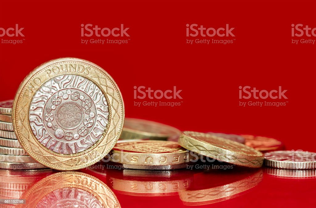 British Coins over Bright Red Background stock photo