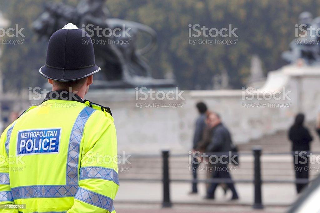 A British cop standing guard at Buckingham Palace stock photo